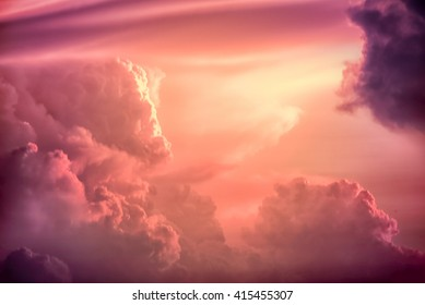 Color toned image, Dramatic sunset sky with colorful clouds.