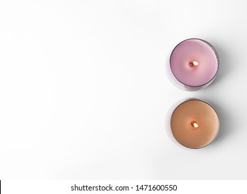 Color wax candles in glass holders isolated on white, top view
