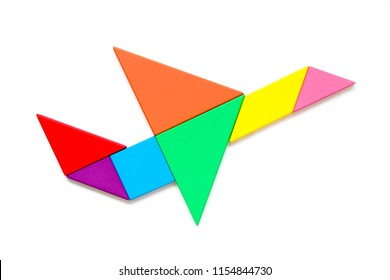 Color wood tangram puzzle in airplane shape on white background