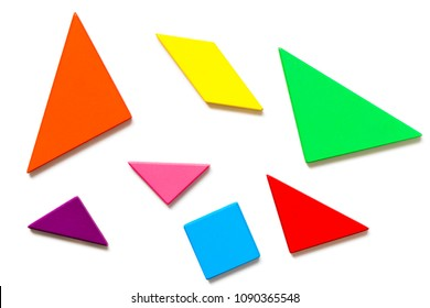Color wood tangram puzzle in geometric shape wait to build on white background
