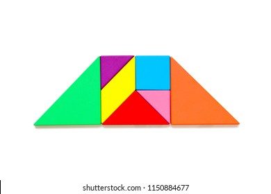 Color wood tangram puzzle in trapezoid shape on white background