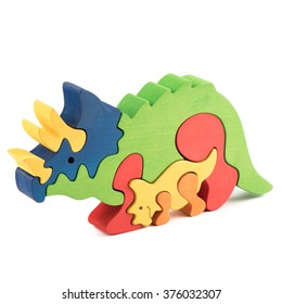 color wooden creative dino puzzle toy on white