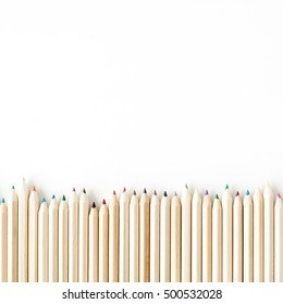 Color wooden pencils isolated on white background.  Close up, flat lay