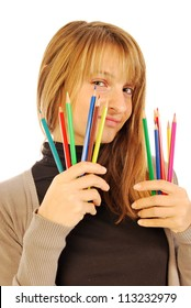 Color the world - 170 - A girl holds in hands of colored pencils