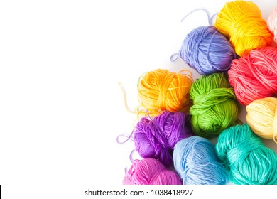 Color yarn for knitting, knitting needles and crochet hooks. White background. Isolate.