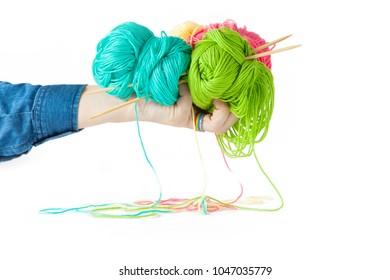 Color yarn for knitting, knitting needles and crochet hooks. White background. Isolate.