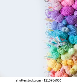 Color yarn for knitting, knitting needles and crochet hooks. yellow background.