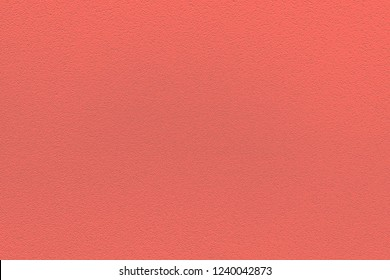 Color of the year 2019: Living Coral. Texture of colored porous rubber. Fashionable pantone color of spring-summer 2019 season. Modern background or mock up with copy space