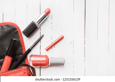 Color of the year 2019 Living coral . COY Livingcoral. women's cosmetics, nail polish and lipstick. flatlay