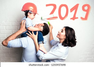 Color of the year 2019 Living coral. Pantone.happy family paints the wall home repairs