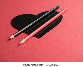 Color your love, heart with colorful pencil on red background. St. Valentine's Day. Top view. Copy space.