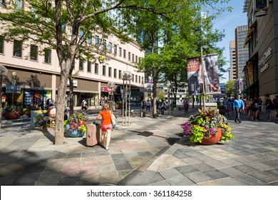 ?DENVER, COLORADO - AUGUST 25: Views of the main shopping street 16th Street in Denver on August 25, 2015. On this street are free public buses driving and it provides lot of shopping opportunities.