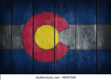 colorado flag on old wooden wound