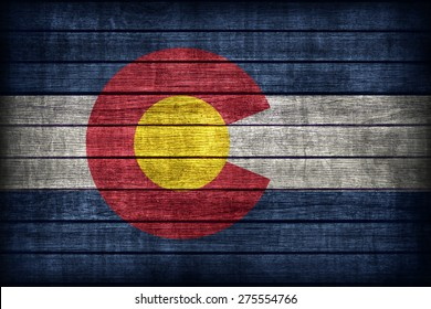Colorado flag pattern on wooden board texture ,retro vintage style