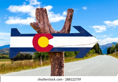 Colorado Flag wooden sign with road background
