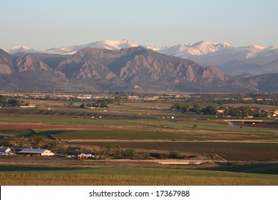 Colorado front range of the rocky mountains and Boulder FlatIrons  as seen  at sunrise in early summer from Broomfield, Colorado