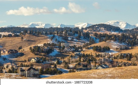 Colorado Living. Golden, Colorado - Denver Metro Area Residential Winter Panorama with the view of a Front Range mountains ion the distance