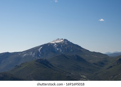 Colorado mountain landscape Twin Sisters Peaks with blue sky and green forest