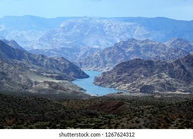 Colorado River in Arizona meanders through craggy mountainous terrain.