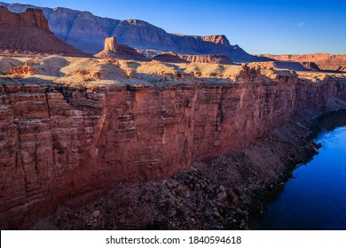 The Colorado River flows through Marble Canyon on it's way to the Grand Canyon.  The Vermillion Cliffs in the background.