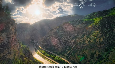 """The Colorado River Flows Under a Sunset in the Glenwood Canyon in Glenwood Springs, Colorado off of Interstate 70. """"I-70"""""""