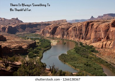 Colorado river shot from Moab Rim Jeep trail in Moab Utah with a quote about being thankful.