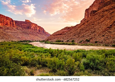 Colorado River Sunset in Moab, Utah with Red Sandstones.