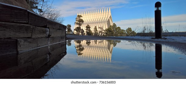 COLORADO SPRINGS, CO - DECEMBER 13, 2015: United States Air Force Academy Cadet Chapel, reflected in a puddle