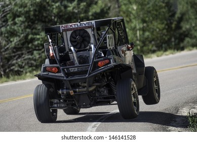 COLORADO SPRINGS, CO - JUNE 30: David Meyer #211 drives a Polaris RZRXP900 in the Exhibition Powersports Class at the Pikes Peak International Hill Climb on June 30, 2013 in Colorado Springs.