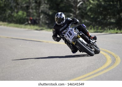 COLORADO SPRINGS, CO - JUNE 30: Joseph B. Toner #16 rides a Kawasaki 650R to 2nd place in Heavyweight Supermoto at the 2013 Pikes Peak International Hill Climb on June 30, 2013 in Colorado Springs.