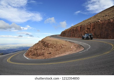 Colorado Springs, CO/United States- 09/16/2017: A Jeep travels up a winding mountain road in Colorado Springs.