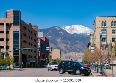 Colorado Springs, MAY 4: Street view with snow mountain on MAY 4, 2017 at Colorado Springs, Colorado