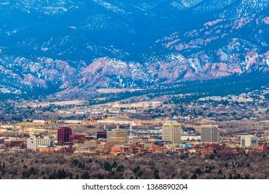 Colorado Springs, Colorado, USA downtown skyline and mountains at dusk.