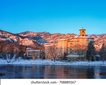 Colorado Springs, Colorado USA - March 1, 2007: The Broadmoor Resort West Tower across Cheyenne Lake on a frosty late winter morning at dawn with Rocky Mountains front range under a brilliant sky.