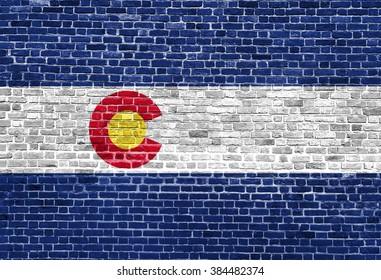 Colorado US flag painted on old vintage brick wall