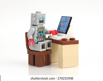 Colorado, USA - April 17, 2015: Studio shot of stack of Lego robot at computer. Legos are a popular line of plastic construction toys manufactured by The Lego Group, a company based in Denmark.