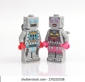 Colorado, USA - April 17, 2015: Studio shot of stack of Lego robots in love. Legos are a popular line of plastic construction toys manufactured by The Lego Group, a company based in Denmark.