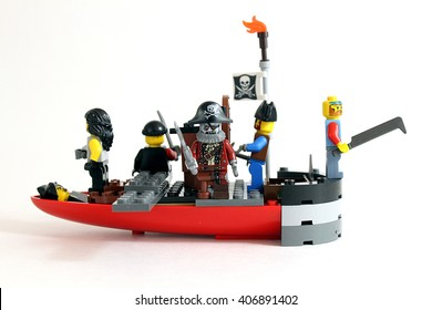 Colorado, USA - April 17, 2016: Studio shot of boat made of LEGO bricks with a variety of pirate minifigures aboard.