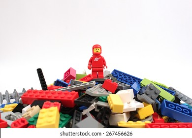 Colorado, USA - April 7, 2015: Studio shot of Lego astronaut on bricks. Legos are a popular line of plastic construction toys manufactured by The Lego Group, a company based in Denmark.