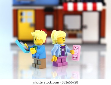 Colorado, USA - December 7, 2016: Studio shot of LEGO minifigure girl and boy distracted by their phones.
