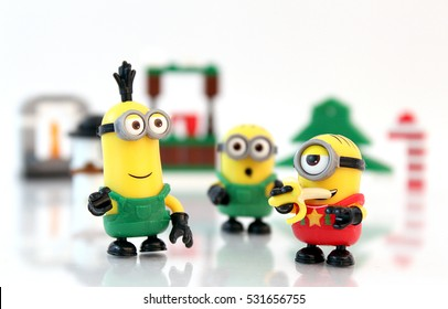 Colorado, USA - December 7, 2016: Studio shot of LEGO minifigure Minions Bob, Stuart, and Kevin in a cute holiday scene.
