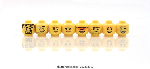 Colorado, USA - Feb. 26, 2015: Studio shot of Lego heads in a row. Legos are a popular line of plastic construction toys manufactured by The Lego Group, a company based in Denmark.
