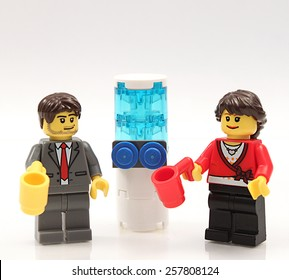 Colorado, USA - Feb. 26, 2015: Studio shot of Lego businesspeople at the water cooler. Legos are a popular line of plastic construction toys manufactured by The Lego Group, a company based in Denmark.