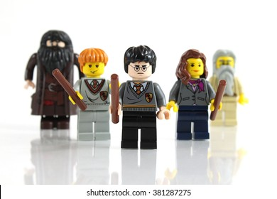 Colorado, USA - February 14, 2016: Studio shot of LEGO minifigure Harry Potter leading the way with Ron, Hermoine, Dumbledore, and Hagrid. Photo isolated on white background.