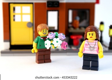 Colorado, USA - July 16, 2016: Studio shot of LEGO guy giving his angry girlfriend flowers. Shot isolated on white background.
