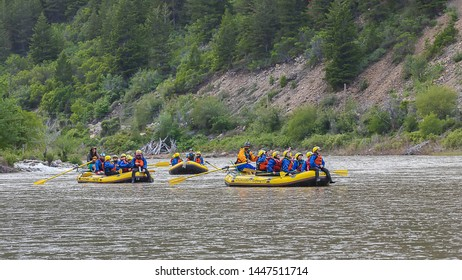 Colorado, USA- June 03, 2019: Group of men and women with guide rafting at Colorado River in three boats