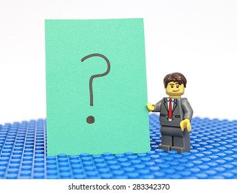 Colorado, USA - June 1, 2015: Studio shot of Lego minifigure with question mark Sign. Legos are a popular line of plastic construction toys manufactured by The Lego Group, a company based in Denmark.