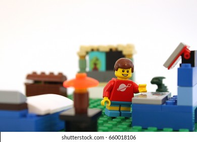 Colorado, USA - June 14, 2017: Studio shot of cute LEGO minifigure boy in his bedroom. Photo isolated on white background.