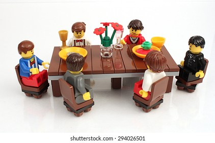 Colorado, USA - June 27, 2015: Studio shot of Lego minifigures portraying dinner scene on white background.