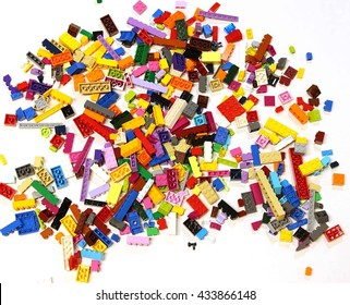 Colorado, USA - June 8, 2016: Studio shot of LEGO bricks in a pile with a variety of colored pieces isolated on white background.
